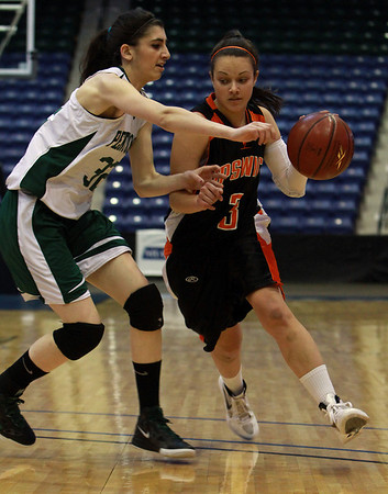 Ipswich senior Shannon McFayden (3) right, drives to the hoop past Pentucket's Tess Noguera (32) left. The Tigers fell to the Sachems 49-30 on Saturday morning in the D3 North Girls Final at the Tsongas Center in Lowell. David Le/Staff Photo