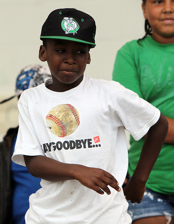 Jamaal Belle, 10, dances along to a song during the Beverly Homecoming Lip Synching Competition on Tuesday evening at Lynch Park. David Le/Staff Photo