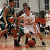 Beverly: Beverly junior Dom Abate drives into the paint around two Lynn Classical defenders. David Le/Salem News