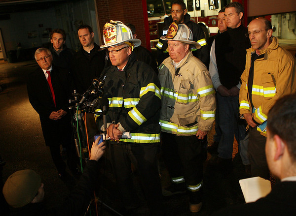 Peabody: Fire Chief for the City of Peabody Steven Pasdon, center, speaks with the media at a press conference on Friday evening to discuss the 3-alarm fire at 5 Hancock St. David Le/Salem News