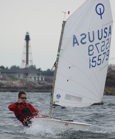 Marblehead: A participant in the Marblehead Junior Race week turns sharply towards the finish line with the Marblehead Lighthouse in the background. The Pleon Yacht Club in Marblehead plays host for Marblehead Junior Race Week which kicked off on Monday afternoon. Photo by David Le/Salem News