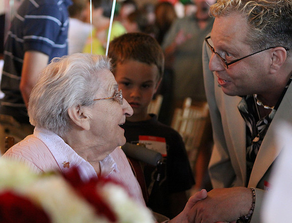 Danvers: Aquilina Bucci, left, is greeted by Steven Bucci and waves of family members at her 100th birthday party held on Saturday afternoon at the Danversport Yacht Club in Danvers. Photo by David Le/Salem News