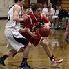 Masco point guard Alex Brown (5) right, drives into the lane against Hamilton-Wenham's Ryan Willis (20) left. David Le/Salem News