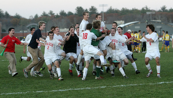 The Masco Boys Soccer team mob goalkeeper Derek Grammer (center) after he came up with multiple big saves and Justin Clark (18) drove home a penalty kick to propel the Chieftans to the semi-final round of the MIAA State Tournament. David Le/Salem News