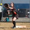 Beverly first baseman Meaghan McLaughlin reaches out to snag a throw to first against Peabody on Friday afternoon. David Le/Staff Photo