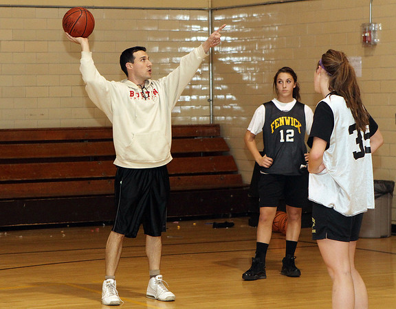 Peabody: First year head coach for Bishop Fenwick, Adam DeBaggis, gives instructions at practice on Wednesday night,  David Le/Salem News