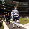 University of Maine captain and Salem native Will O'Neill walks across the diamond at Fenway Park at the start of UMaine's game against UNH. David Le/Salem News