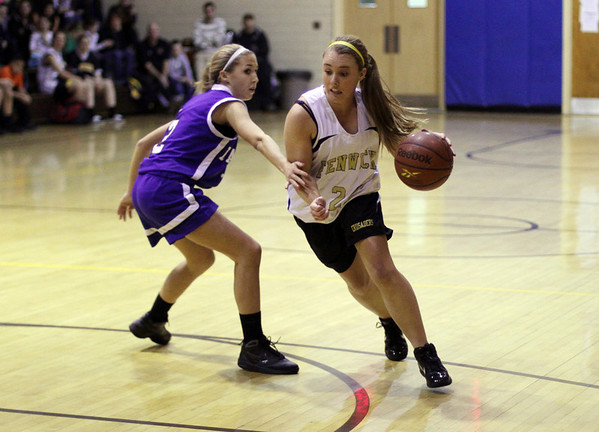 Peabody: Bishop Fenwick's Alicia Villett (24) right, drives to the hoop against Danvers guard Delaney Zecha on Wednesday night. David Le/Salem News