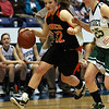 Ipswich junior Julia Davis (32) left, drives past Pentucket's Leigh McNamara (25) right. David Le/Staff Photo