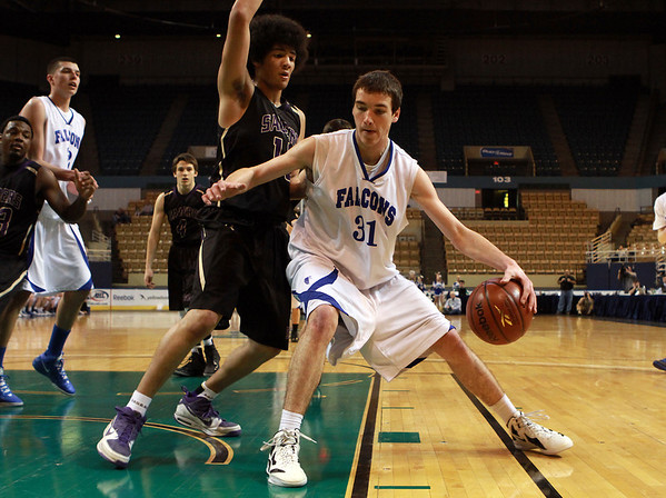 Danvers High School junior Dan Connors (31) right, posts up St. Joseph's Mike McMahon (14) left, on Saturday afternoon in the D3 State Championship at the DCU Center in Worcester. David Le/Staff Photo