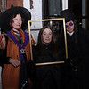 Elizabeth Merrick, Laurie Gagnor, and Brian Merrick of Somerville, pose for a picture outside Rockafellas in Salem on Halloween Night. David Le/Staff Photo.