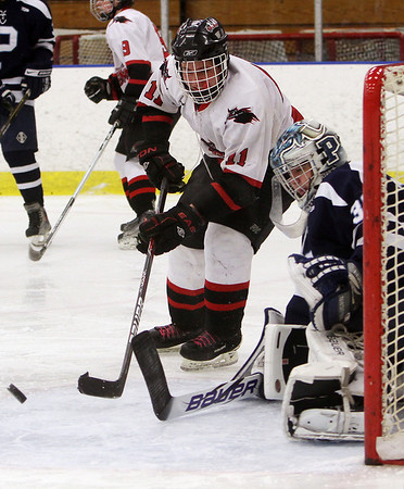 Salem captain Paul DiMarino (11) left, and Peabody goalie Joe Powers (35) right, watch as the puck bounces through the crease on Wednesday afternoon. David Le/Salem News
