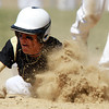 Bishop Fenwick's Mike MacKensie dives headfirst back to the base during a rundown against Peabody on Saturday morning. David Le/Staff Photo