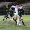Danvers High School junior captain Eric Martin dribbles through the Pentucket defense. Martin scored the first of two Falcon goals. David Le/Salem News