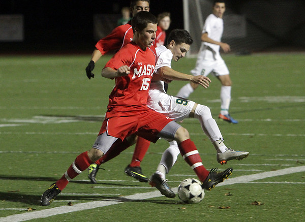 Masco freshman Henry Behrens (15) challenges a Greater New Bedford player for the ball on Tuesday night. David Le/Salem News