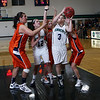 Endicott College's Katelyn Wright (3) goes up for a shot in a crowd of players on Thursday night. David Le/Salem News