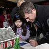 Mark Rieper, and his daughter Magdalena, 6, of Marblehead look at gingerbread houses on display at the Lee Hooper Mansion on Sunday. David Le/Salem News