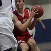 Masco's Adam Bramanti looks towards the basket while being covered by multiple Hamilton-Wenham defenders. David Le/Salem News