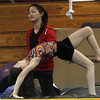 Masconomet gymnast and Yellowjackets gymnast instructor, Julia Small, helps Jennifer Forde with a back flip. David Le/Staff Photo.