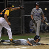 Danvers American's Nic DiScuillo slides safely into home plate as the ball sails past the outstretched glove of Saugus American reliever Hunter Kreis. David Le/Staff Photo
