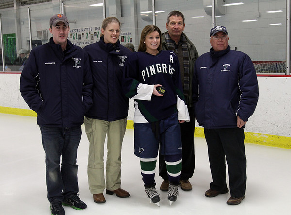 Pingree senior Lily Sabatini, center, recently scored her 100th point as a member of the Highlanders. She was presented with a puck honoring her achievement before Wednesday afternoon's game against Dana Hall. She is surrounded by, from left, assistant coach Sam Mathey, Head Coach Sarah Carpenter, Athletic Director Alan McCoy, and assistant coach Neil Valeriani. David Le/Staff Photo