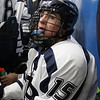 St. John's Prep junior NIck Gianelli (15) catches his breath on the bench while playing Austin Prep. David Le/Salem News