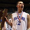 Danvers senior captain George Merry brings the MIAA D3 State Championship over to the stands to share with the Danvers fans that traveled to the DCU Center in Worcester to see the Falcons take home their first State Basketball Title on Saturday afternoon. David Le/Staff Photo