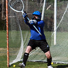 Danvers High School junior goalie Marina Belakonis deflects a shot up and over the net at practice on Tuesday. David Le/Staff Photo