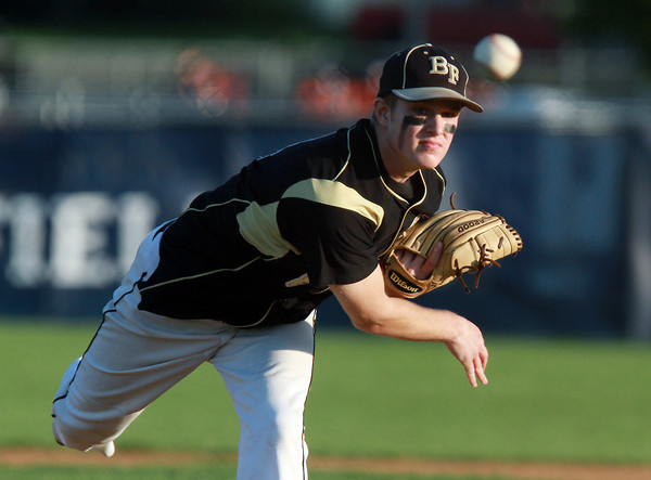 Bishop Fenwick starting pitcher Andrew Lessano fires a strike against Danvers on Thursday evening. David Le/Staff Photo