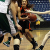 Ipswich freshman point guard Masey Zegarowski (5) center, drives to the basket while surrounded by Pentucket defenders. The Sachems were too much for the Tigers and defeated them 49-30 on Saturday morning at the Tsongas Center in Lowell. David Le/Staff Photo