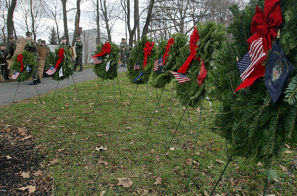 A row of 7 wreaths, which were placed in honor of the Air Force, Army, Coast Guard, Marines, Merchant Marine, and POW/MIA sat at the entrance of St. Mary of the Annunciation Cemetary in Danvers on Saturday afternoon following a Wreaths Across America presentation.David Le/Salem News