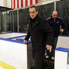 Salem State Men's Hockey Head Coach Bill O'Neill, leaves the bench after he recorded his 500th win as head coach of the Vikings. David Le/Staff Photo