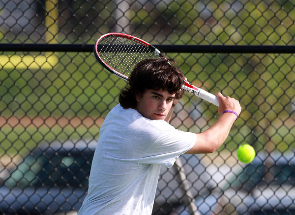 Beverly High School first singles player Josh Cronin keeps his eyes on the ball as he returns a volley against Austin Prep on Friday afternoon. David Le/Staff Photo