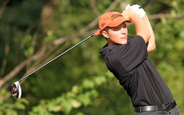Beverly junior Josh Cairns watches his tee shot on Friday afternoon. David Le/Staff Photo