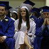 Danvers: From left, Danvers High School Seniors, Ryan Quinlivan, Brianna Quinn, and Connor Raftery, listen to one of the speeches at their commencement ceremony held on Saturday afternoon in the Danvers High Gymnasium