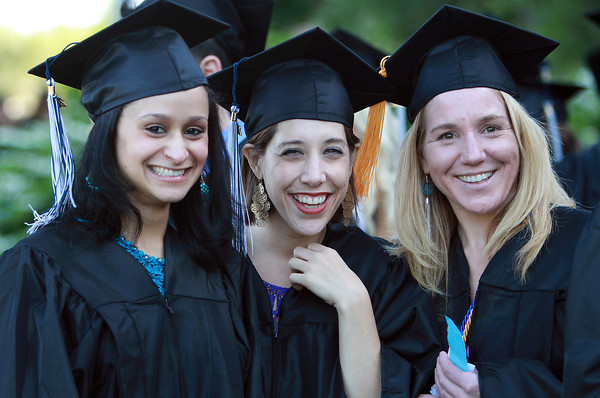 North Shore Community College soon-to-be graduates, Elizabeth Moya, left, of Revere, Victoria Murphy, center, of Beverly, and Heather Ruma, right, of Essex, pose for a photo before marching into the O'Keefe Center at Salem State University. David Le/Staff Photo<br /> /, North Shore Community College soon-to-be graduates, Elizabeth Moya, left, of Revere, Victoria Murphy, center, of Beverly, and Heather Ruma, right, of Essex, pose for a photo before marching into the O'Keefe Center at Salem State University. David Le/Staff Photo<br /> /