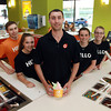 Steve Giannone, center, Manager of Orange Leaf, a brand new frozen yogurt shop at the corner of Lafayette and Derby Streets, stands with a few of his staff members from left, Cam Little, of Milford, Tori Holzwasser, of Swampscott, Alexa Gross, of Marblehead, and Ashley Fuller, of Peabody. David Le/Staff Photo