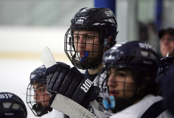 St. John's Prep senior captain Nick Pandelena (21), watches the action on ice. David Le/Salem News