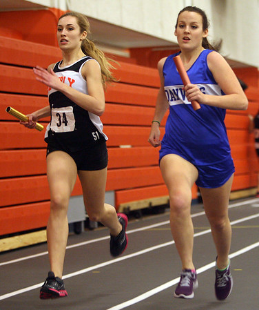 Beverly: Beverly's Madison Shropshire, left, and Danvers' Kristin Yost, right, compete in the 4x400 relay on Thursday afternoon. David Le/Salem News