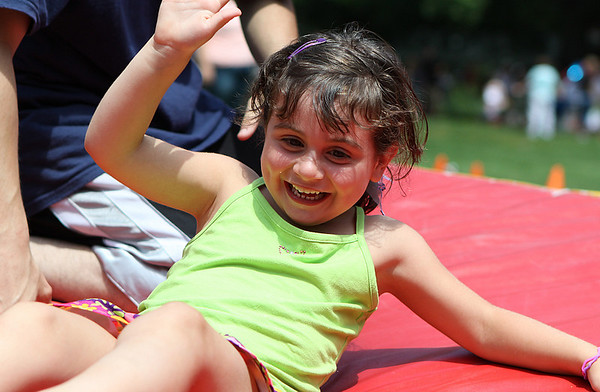 Danvers: Abigail Malone, age 5 of Danvers, happily and successfully lands a front-tuck roll at Endicott Park Day on Saturday afternoon in Danvers. Photo by David Le/Salem News