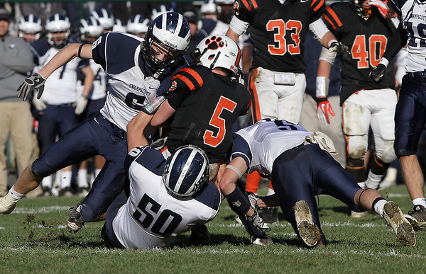 A host of Swampscott defenders led by Aidan Lang (6), Mark Lausier (50), and Robert Serino (5) bring down Beverly receiver (5) on Saturday afternoon. David Le/Salem News