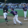 Beverly: Beverly West leadoff hitter and thirdbaseman Matt Townsend can't avoid the tag of Peabody West secondbaseman Kyle Lynch while shortstop Traverse Briana looks on. The District 15 Little League Championship Game between Peabody West and Beverly West at Harry Ball field in Beverly. The game was postponed in the bottom of the 5th inning on Friday evening due to lightening and will resume Saturday afternoon at 5. Photo by David Le/Salem News