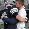 Hamilton-Wenham senior Taylor Drinkwater, left, gets a hug and encouraging words from his brother and assistant coach Mike after the Generals fell to Bourne High School 16-14 in the EMass Division IIIA Superbowl at Manning Field in Lynn on Saturday afternoon. David Le/Salem News