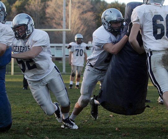 Hamilton-Wenham offensive linemen Ryan Foringer (52) and Kevin Anthony (58) work on blocking technique at practice on Thursday afternoon. David Le/Salem News
