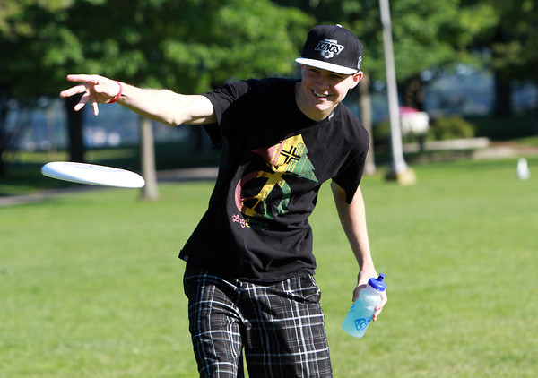 Sam Lindsay, 18, of Beverly, tosses a frisbee around with some friends at Lynch Park on a warm Thursday afternoon. David Le/Staff Photo