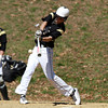Bishop Fenwick left fielder Joe Levasseur lines a base hit against Peabody on Saturday morning. David Le/Staff Photo