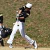 Bishop Fenwick left fielder Joe Levasseur lines a base hit against Peabody on Saturday morning. David Le/Staff Photo