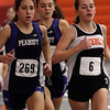 Beverly's Allison Collins, right, competes against Peabody's Catarina Rocha left, and Peabody's Sydney May, center, in the 1 mile race on Thursday afternoon. David Le/Salem News