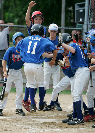 Danvers: Danvers American leadoff hitter and shortstop Devonn Allen is clobbered at home plate by his teammates after Allen hit a massive first inning home run off of Peabody West starting pitcher Jake Doherty. The eleven year-old Jimmy Fund Championship Game was held on Saturday afternoon at Tapley Field in Danvers. Danvers American barely edged out Peabody West in a nail-biter 8-7. Photo by David Le/Salem News