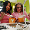 Mattea Whitlow, of Salem, 9, left, and Sarah Cayouette-Gluckman, also 9 of Salem, load various toppings onto their frozen yogurt at Orange Leaf, a new frozen yogurt shop at the corner of Lafayette and Derby Streets in downtown Salem. David Le/Staff Photo